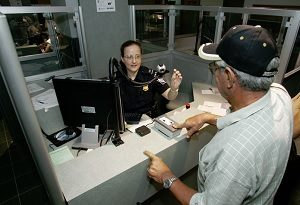 CBP inspects reentry permit for permanent resident