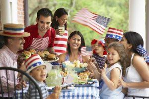 family celebrating fourth of july holiday