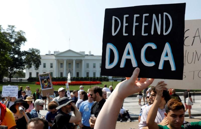 Protesters march to defend DACA status