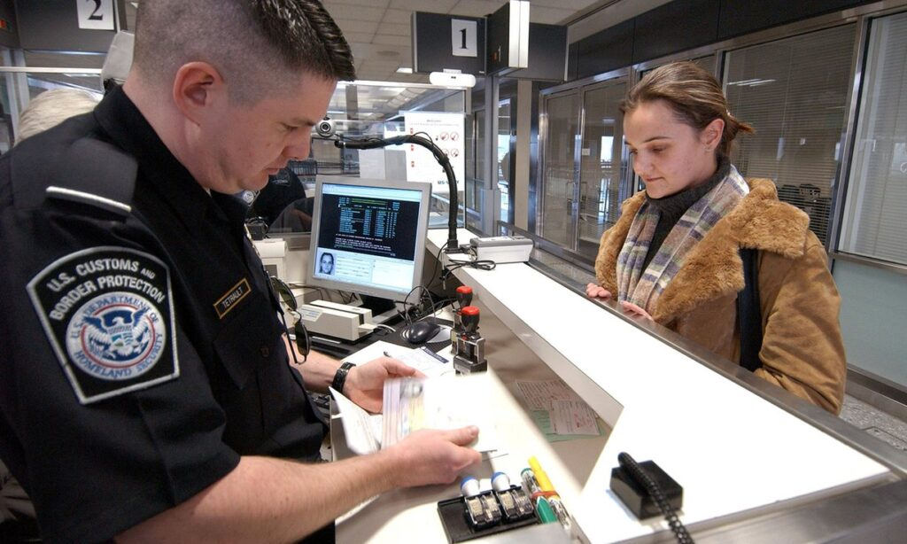 CBP officer inspects advance parole travel document