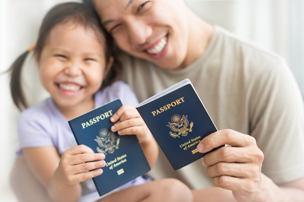 father and daughter show passports and how to get u.s. citizenship