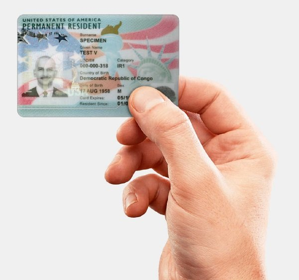 green card holder compares adjustment of status vs consular processing