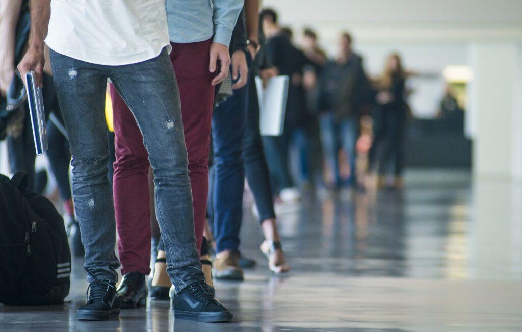Immigrants wait - visa wait times could improve