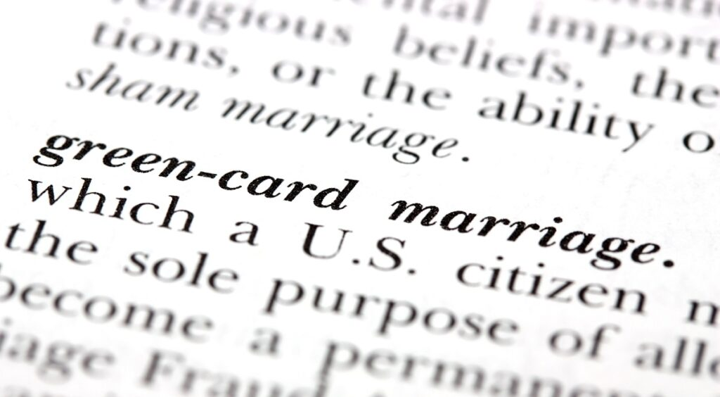 Photo of printed book page the defines green card through marriage