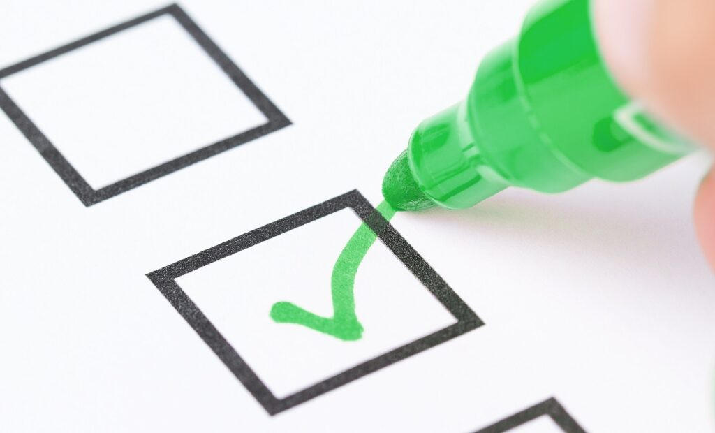 Pen marking the N-400 document checklist for naturalization